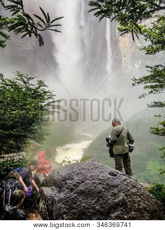 Canaima, Venezuela - August 07, 2014: Tourists Visiting Angel Falls (salto Angel), The Highest Water