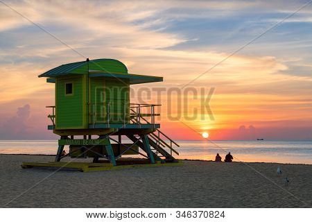 Miami Beach At Sunrise And Lifeguard Tower, South Miami Beach, Florida.