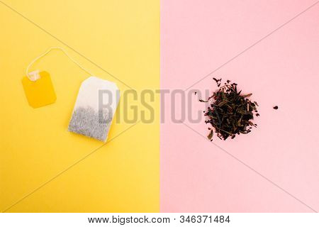 Tea Bag And Loose Leaf Tea Flat Lay On Colorful Trendy Yellow And Pink Backgrounds. Top View Copy Sp
