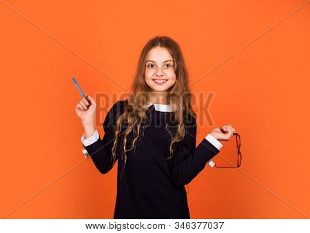 Cute Genius. Girl Genius Brown Background. Genius Little Child Hold Pen And Glasses. School And Educ