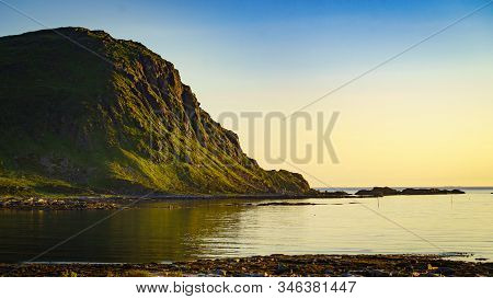 Coast Of Vestvagoy Island, Uttakleiv Location. Seascape With Scenic Shoreline High Mountains At Midn