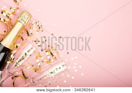 Valentines Day Champagne Bottle Flute Glasses Golden Confetti Hearts And Serpentine On Pink Backgrou