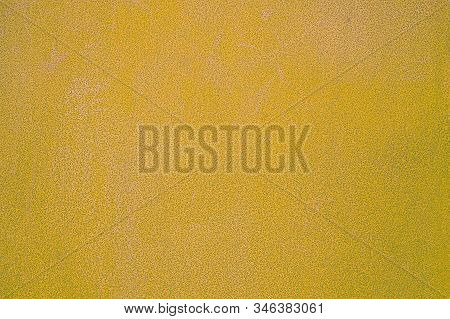 Yellow  Metal Texture With Scratches And Cracks. Weathered Steel Textur. Close-up Rusty Metal Sheet