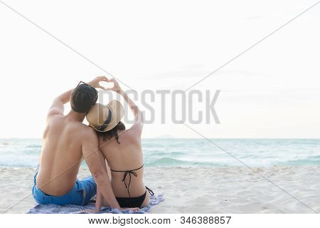Couple Happy Vacations And Romantic On Sea Beach.  Young Asia People Man And Woman Honeymoon Love An