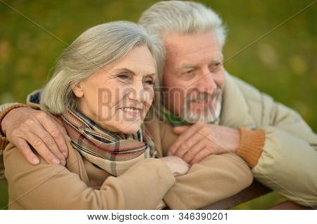 Smiling Senior Couple Embracing In Autumn Park