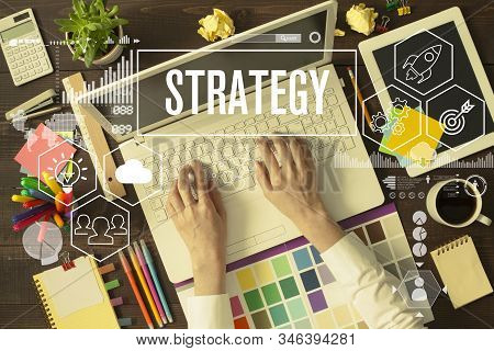 Business Strategy On Office Desk. Business Woman Working In Office At Background, Strategy Word And