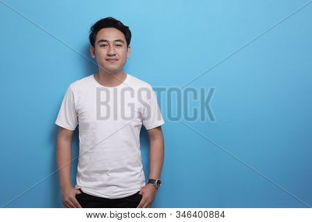 White Shirt Template, Asian Male Model Wearing T-shirt With Copy Space Against Blue Background, Fron