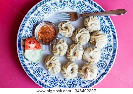 Flat Lay Of Nepalese Momo Dumplings With Yak Meat