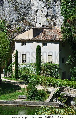 Provence, France - July 8, 2014: Medieval Village Fontaine De Vaucluse On The River Shore. The Poet