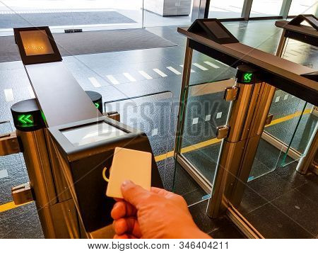 Men Hand Reaching To Use Rfid Key Card To Access Pass Turnstile Area. In Building Security Only For