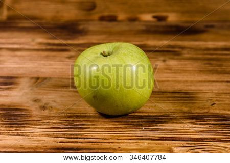 Ripe Green Apple On Rustic Wooden Table