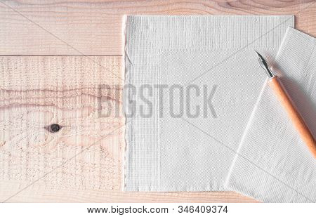 Tissue Paper With Dip Pen On Wooden Table. Tissue Paper Or Note Paper And Space For Text Or Copy, Li