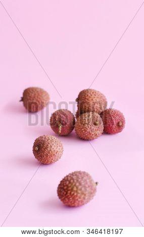 Fresh Litchi Fruits On A Light Pink Backgrpund Close Up
