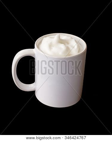 White Coffee Mug With Frothed Milk Mockup With Room For Text Or Graphic On The Coffee Cup.  Isolated