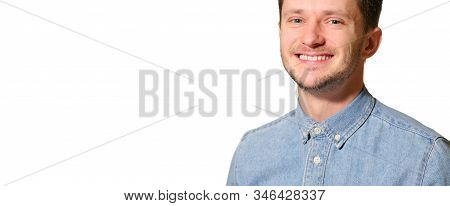 Young Handsome Man Looking Happy And Goofy With A Broad, Fun Smile On White Background