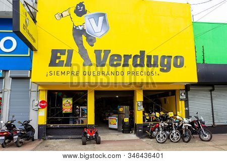 Puerto Limon, Costa Rica - December 8, 2019: The Front Of A Motorbike Repair Shop At Puerto Limon, C