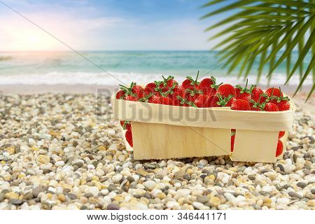 Strawberries In A Basket On The Shore Of The Warm Sea.