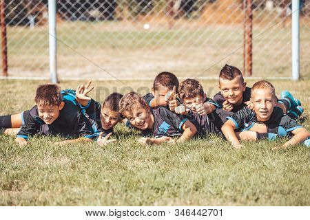 Soccer Drills: The Slalom Drill. Youth Soccer Practice Drills. Young Football Player Training On Pit
