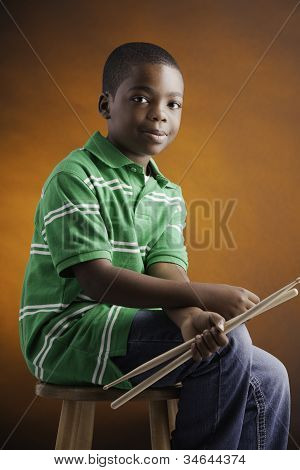 Student And Drum Sticks.