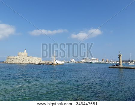 Harbor Of Rhodes, Greece , Old Venetian Watch Tower At Old Seaport Of Rhodes Island.ancient Port.lig