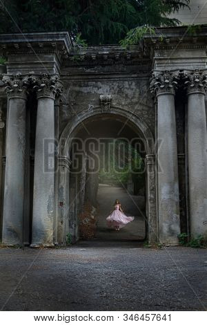 young caucasian girl woman in pink fashion dress outdoors  sunlight nature castle