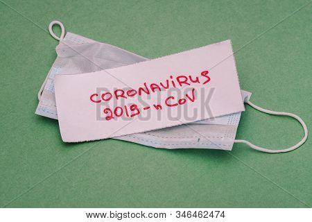 New Coronavirus 2019-ncov. Text On Paper With A Breathing Mask On A Green Background. Mers-cov Middl