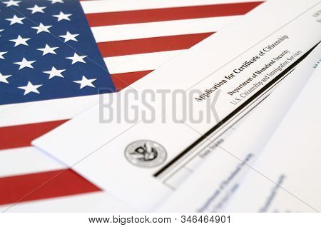 N-600 Application For Certificate Of Citizenship Blank Form Lies On United States Flag With Envelope