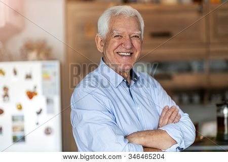 Smiling senior man in his home