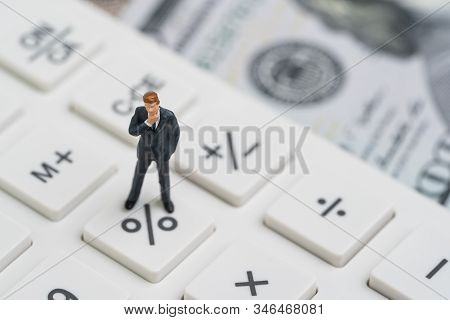 Miniature People Business Man Standing And Thinking On Calculator Percentage Button Using As Fed Con