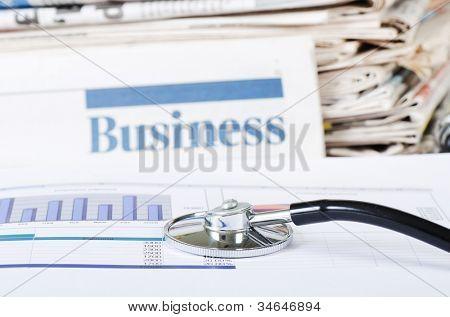 Stethoscope on stock chart - market analysis