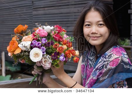 women and bouquet flowers in hand vintage color style