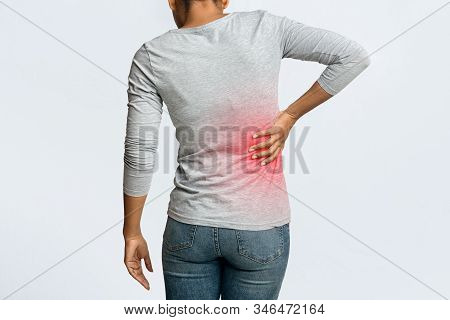 Kidney Stones. Afro Woman Holding Her Hand Behind Back, Pain In Kidney, Inflamed Zone Highlighted In