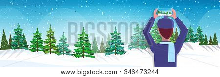 Travel Blogger Using Smartphone Camera Photographing Snowy Forest During Hiking Blogging Live Stream