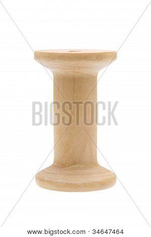 Empty wooden thread spool