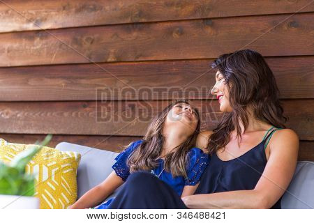 Portrait Of A Young Hispanic Mother And Her Daughter.