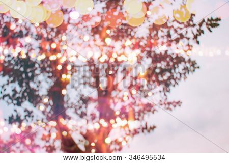 Defocused Light Bulbs Decoration Bokeh Night Trees Branch In Holiday Festival Background, Romantic P