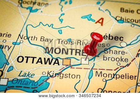 Prague, Czech Republic - January 12, 2019: Red Thumbtack In A Map. Pushpin Pointing At Montreal City