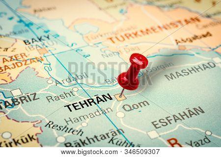 Prague, Czech Republic - January 12, 2019: Red Thumbtack In A Map. Pushpin Pointing At Teheran City