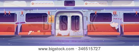 Metro In Getto, Empty Subway Tube Wagon Interior With Graffiti, Broken Seats And Garbage Around. Old