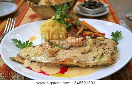 Closeup Mouthwatering Pan-seared Lake Trout With Creamy Shrimp Sauce