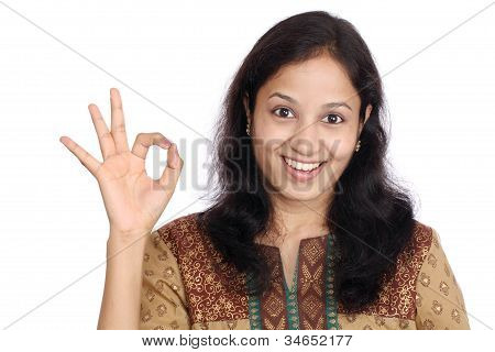 Portrait Of Young Indian Woman With Ok Sign