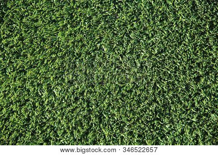 Green AstroTurf. Green Plastic Grass. Fake or pretend green grass or lawn on the ground.