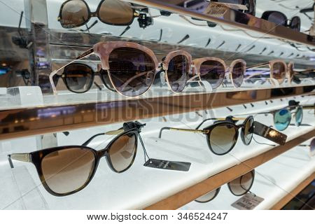 Heathrow, Britain - August 15, 2019: Designer sunglasses for sale in duty free store at airport