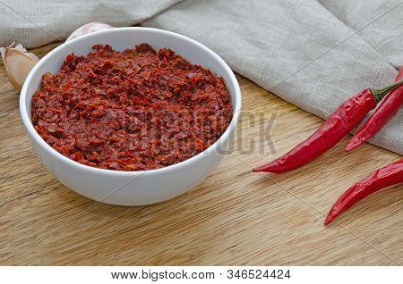 Traditional Maghrebi Hot Chili Pepper Sauce Paste Harissa. Tunisia And Arabic Cuisine Adjika Close U