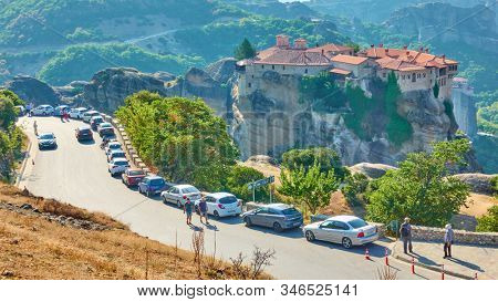Meteora, Kalamaka, Greece - September 19, 2019:  Many tourist's cars parked near The Monastery of Varlaam in Meteora