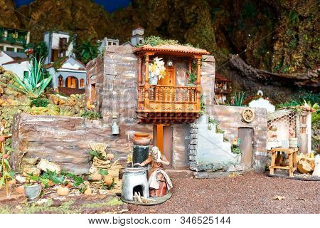 Candelaria, Tenerife, Spain - December 12, 2019: Detail of Christmas Belen -  Crib, Nativity Scene, statuettes of people and houses in miniature