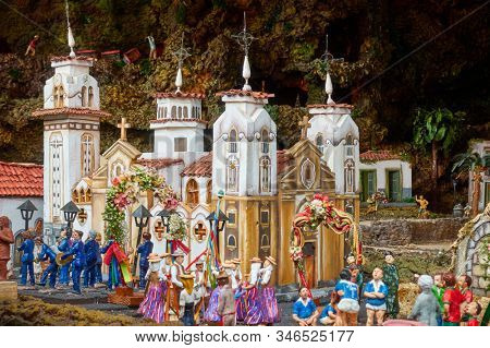 Candelaria, Tenerife, Spain - December 12, 2019: Christmas Belen -  Statuettes of people and houses in small-scale