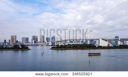 Landscape Of Rainbow Bridge And Tokyo Skyline In The Afternoon At Odaiba, Japan, Tokyo