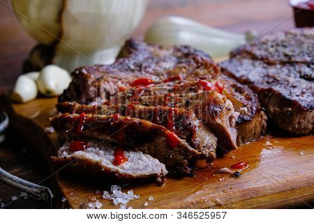 Roasted Pork Loin With Ribs On A Wooden Background