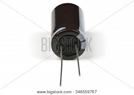 Electrolytic Capacitor Isolated On White Background. High Resolution Photo. Full Depth Of Field.